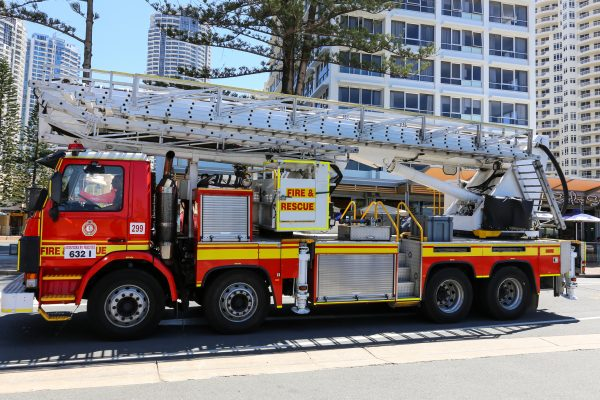 Gold Coast, Australia - October 7, 2016: Modern red fire and rescue truck with ladder in the streets of Surfers Paradise.